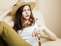 Young pretty woman waiting alone in modern loft studio, fashion Royalty Free Stock Image