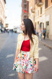Young pretty woman walking in the city street Royalty Free Stock Photos