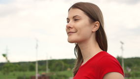 Young pretty woman walking in park, relaxing summer vacation, face smile. Sky on background stock video