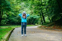 Young pretty woman was interrupted video call while run in the park. Young autumn day Royalty Free Stock Photography