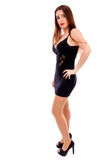 Young pretty woman wearing black evening dress and posing in stu Royalty Free Stock Photos