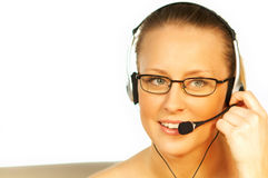 Young pretty woman wearing a phone headset.  royalty free stock images