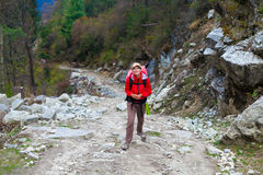 Young Pretty Woman Wearing Red Jacket Backpack Trail Mountains.Mountain Trekking Rocks Path Landscape View Background stock photography