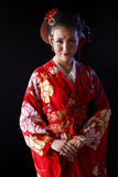 Young pretty woman wearing red kimono royalty free stock photos