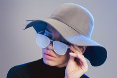 Young pretty woman wearing wide-brimmed hat and sunglasses covered. In frost royalty free stock image