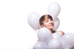 Young pretty woman with white baloons Royalty Free Stock Images