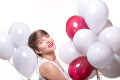 Young pretty woman with white baloons Stock Photo