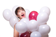Young pretty woman with white baloons Royalty Free Stock Photos