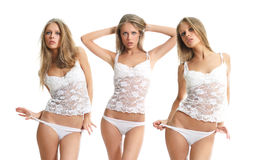 Young pretty  woman in white lingerie Stock Photography