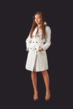 Young pretty woman in white raincoat royalty free stock photos
