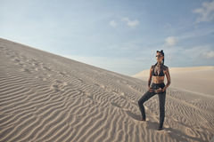 Young pretty woman in white sand dunes like a Stock Image