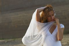 Young pretty woman with white scarf Stock Image