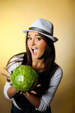 Young Pretty Woman With Green Cabbage Smiling Royalty Free Stock Images