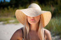 Young Pretty Woman With Hat Relaxing On The Beach Stock Photography