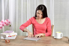 Young pretty woman work in home office Royalty Free Stock Image