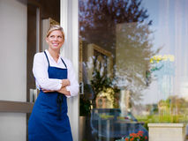 Young pretty woman working as florist in shop Stock Photo