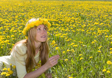 Young pretty woman in wreath of dandelions Royalty Free Stock Images