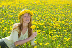 Young pretty woman in wreath of dandelions Stock Image