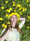 Young pretty woman in wreath of dandelions Royalty Free Stock Photo