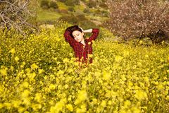 Young woman and flowers Stock Image