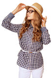Young pretty womanl with retro garb holding her hat against whit stock photos