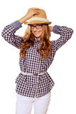 Young pretty womanl with retro garb holding her hat against whit Stock Images