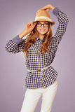 Young pretty womanl with retro garb touching her hat Royalty Free Stock Photo
