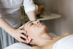 Face massage or beauty treatment in spa salon Stock Photos