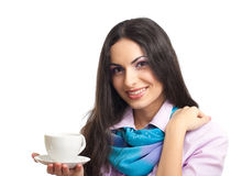 Young pretty women holding coffee cup. Young women holding coffee cup isolated on white Stock Photography