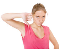 Young pretty women with thumb down Royalty Free Stock Photography