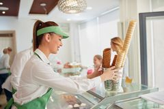 Young woman work in pastry shop royalty free stock image