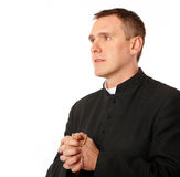 Young priest. With rosary in his hands Stock Photos