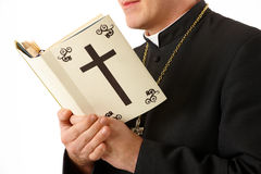 Young priest. With bible in his hands Stock Photo