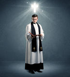 Young priest in giving his blessing Royalty Free Stock Photos