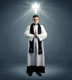 Young priest in giving his blessing Stock Photos