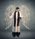 Young priest in giving his blessing Royalty Free Stock Images