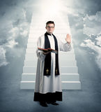 Young priest in giving his blessing Royalty Free Stock Photo