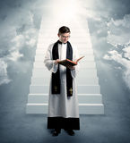 Young priest in giving his blessing Stock Photography
