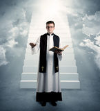 Young priest in giving his blessing Stock Images