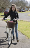 Young priest using a bicycle to visit her parish Royalty Free Stock Photos