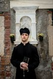 Young priest in venice. With church Stock Images