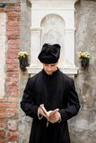 Young priest in venice royalty free stock photo