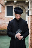Young priest in venice stock image