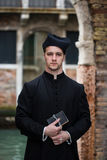 Young priest in venice stock photography