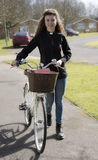 Young priest visiting her parish by bicycle Royalty Free Stock Image