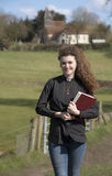 Young priest visiting her parish in the countryside Royalty Free Stock Photography