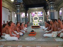 Young priests are singing in the Ramana Ashram in Tiruvanamalai in India Asia. Tiruvanamalai, India -December 8, 2019: Young priests are singing in the Ramana stock image