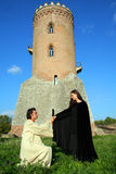 Young prince and princess. Love prince and princess in a medieval place with tower stock photo
