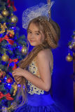 Young princess in a blue evening dress Stock Photos