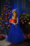 Young princess in a blue evening dress Royalty Free Stock Photo